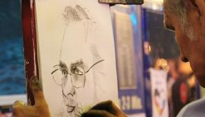 #figuration homme caricaturiste ou portraitiste professionnel pour tournage série américaine